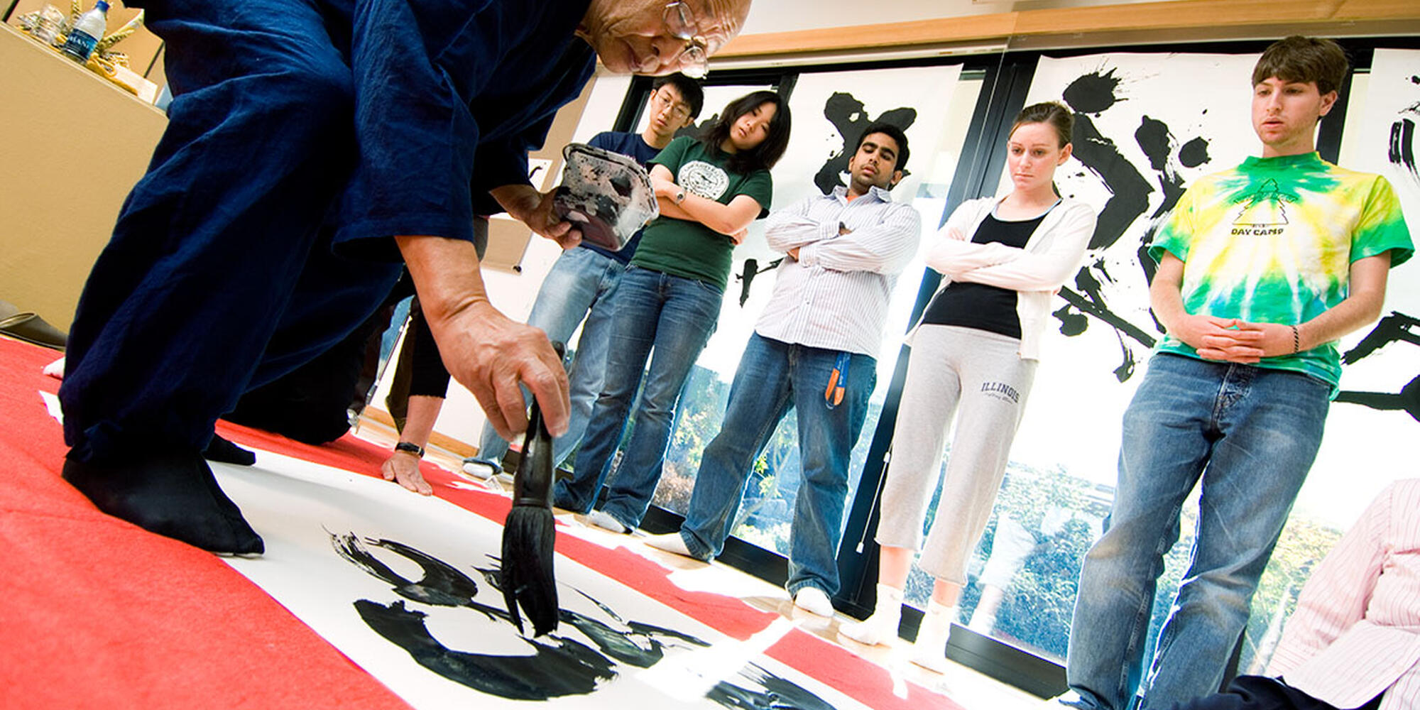 Students watch calligraphy painter